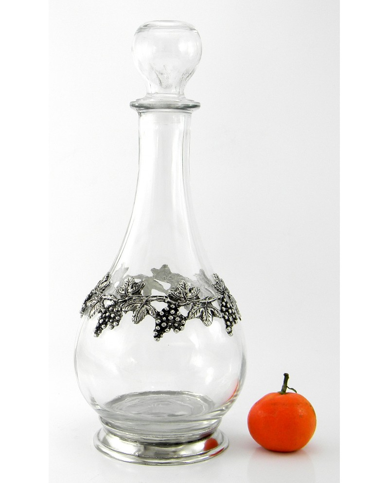 Bottle with raisins in pewter